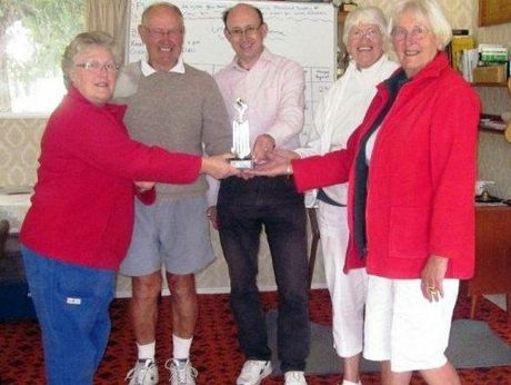 WINNERS: Masterton Croquet Club captain Elaine Laidlaw presents the Four Clubs Trophy to the Carrington line-up of, from left, Harry Murrell, Stewart Pye, Stella Smith and Judy Betts.