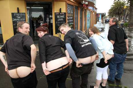 CHEEKY: Pier Side Cafe employees and New Brighton residents are busy practising for the Bare Your Bum for Brighton protest.