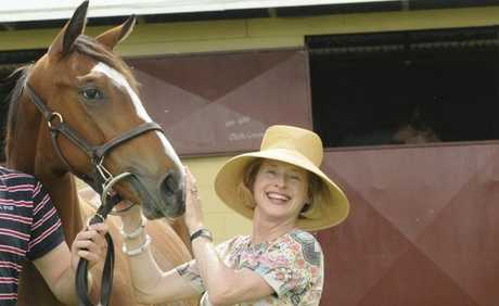 Premier horse trainer Gai Waterhouse looking at Red Dazzler at Eureka Stud.