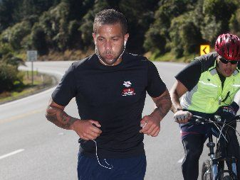 BEATING THE FEET: Rotorua crossfit trainer Jamie Milne fundraising for the Ronald McDonald House, running up the Kaimai Ranges last year. Milne, a strength and conditioning coach for Shane Cameron, says he is confident the boxer can beat Danny Green to claim the IBO world cruiserweight title.