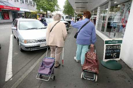 STEADY TRADE: Shoppers in Queen St, Masterton. Retails sales are down slightly on last year. PHOTO/FILE