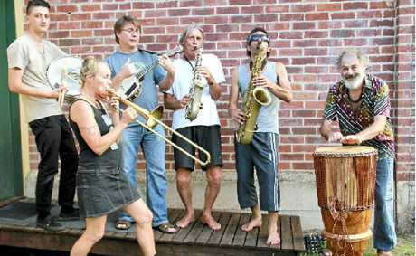 TUNING UP: Musicians rehearse for Sunday's Mullum Music Festival's street parade.