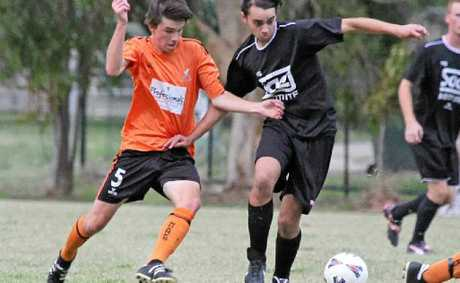 MY BALL: Its a battle for possession during last Fridays game.