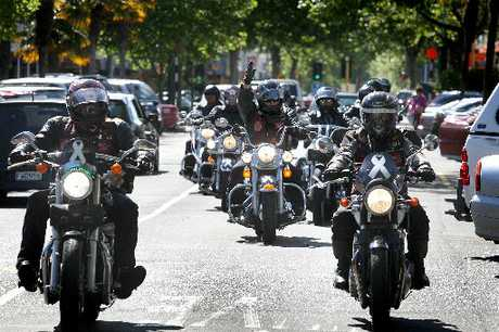 ON THE ROAD: White Ribbon Riders motor along Wanganui's Victoria Ave.PHOTO/ BEVAN CONLEY