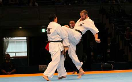 KNEES UP: Wanganui karate expert Pete Parson slips a knee into the chest of Japanese opponent Syodai Yamaguchi during the world championships in Toyama earlier this month. PHOTO/SUPPLIED