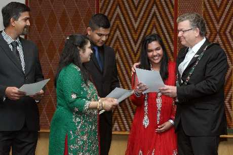 WELCOME: The Faruk family from Fiji were among 32 people to become New Zealand citizens yesterday and daughter Fazia Nisha, beside Rotorua Mayor Kevin Winters, also celebrated her 16th birthday.