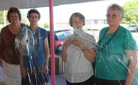 BITE THE HAND: Murgon Lifeline volunteers, Sylvia, Rhondda, Helen and Helene are saddened by the damage to the Christmas display after the window and door of Lifeline was destroyed on the weekend.