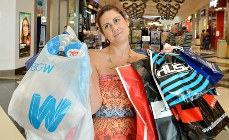 Camilla King navigates the shopping gauntlet at Centro Gympie yesterday in the lead up to Christmas. Many people are finding the stress of buying the 'perfect' present, juggling budgets, credit card bills and crowded shopping centres a handful.