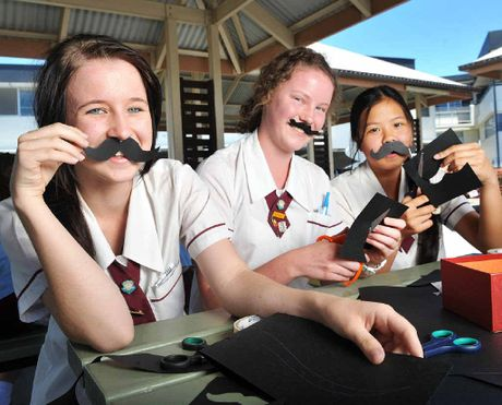 "HIRSUTE MALES? St Mary's College students Tiffani Dakin, Lenore Irvine and Samantha Sayaxang get in the spirit of Movember by making ""moustaches"" to sell at the school."