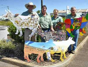 READY TO SELL: All geared up to auction the cow art are (from left) Landmark Toowoombas Anthony Ball, Rick Price, Rachael Matthews and Guy Pitman.