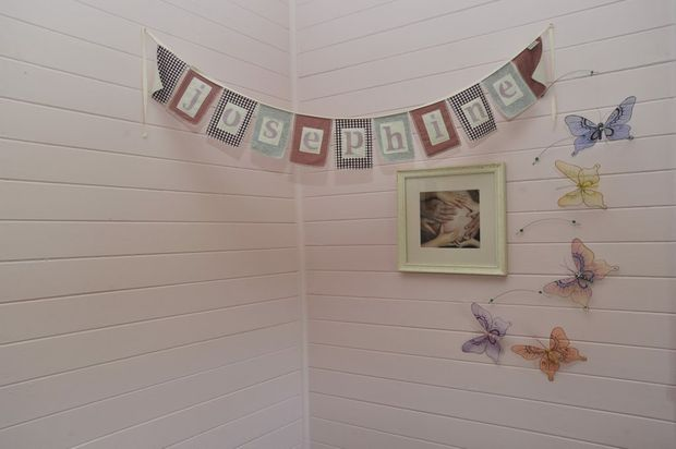 "This is the corner of the nursery room. ""Luckily we had three girls so we didn't have to change the colour!"" explains Jane."