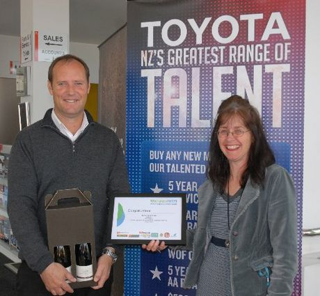 HELPFUL: Terence O'Hara receives his award from Barbara Hyde of Destination Wairarapa for his extra efforts to aid an ill customer.