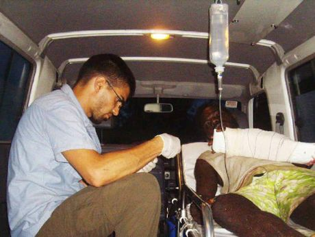 MAKESHIFT THEATRE: Dr Nadim Cody treats a man whose arm was badly wounded by a chainsaw.