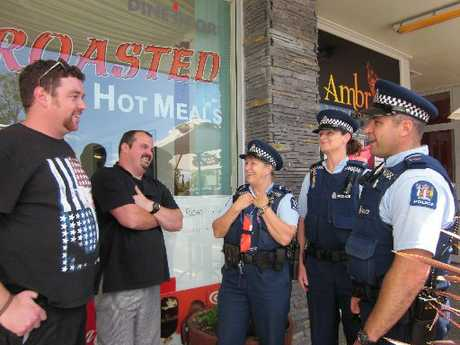 From right, Senior Constable Ian Searle, Constable Karen Millar and Senior Constable Susy Butler chat with locals Vernon Jensen and Matthew Yates.