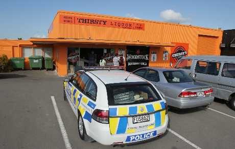 Police at the scene of the raid on the Thirsty Liquor Store in Chapel St.