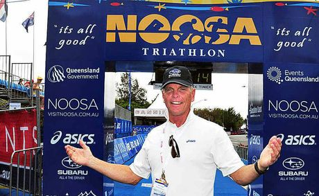 Garth Prowd, pictured at the Noosa Triathlon finish line, received the Marie Watson-Blake Award for Outstanding Contribution to the tourism industry by an individual.