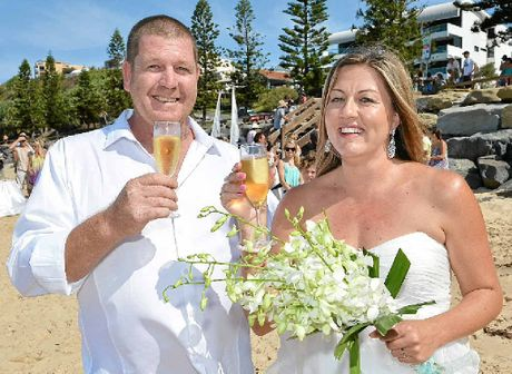 SURPRISE WEDDING: Matt and Laura Ring marry on Moffat Beach after their 14-year engagement.