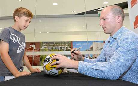 Lockyer signs Zach Grey's football yesterday.