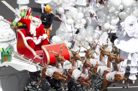 Excitement as the star of the annual Santa Parade makes an appearance in downtown Auckland.