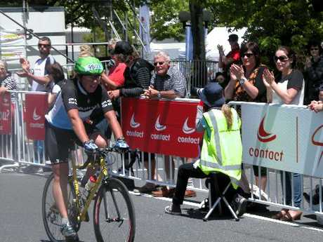 Dr Christine Couldrey crosses the finish line at the Cycle Challenge after completing 1280km (eight laps) around Lake Taupo.