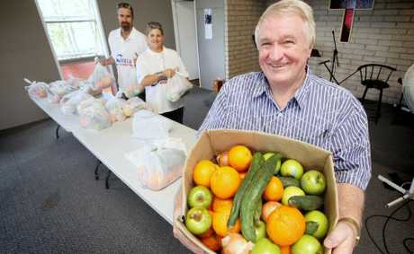 Russell Witham with Sue and Ernie Welfare who are a part of Access which helps to feed the disadvantaged. Photo: Inga Williams / The Satellite