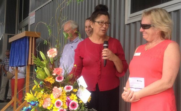 Community stalwart and foodie festival organiser Kerry Turner presented centre manager Wendy Constantine with a bouquet at Saturday's opening.