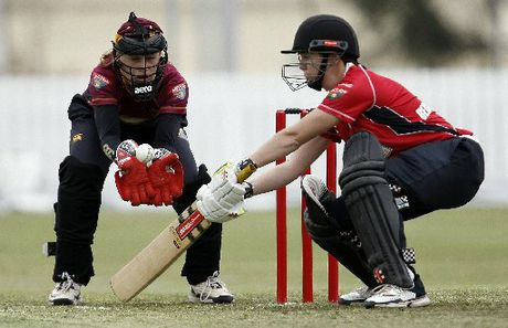Northern Spirit wicketkeeper Natalie Dodd has this ball covered as it beats the bat of Erin Bermingham, Canterbury, during their Twenty20 match at Cobham Oval.