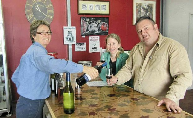 Winemaker Louise Samuel, of Lucas Estate, explains the virtues of her wines to Sunshine Coast visitors Len and Ellie Brodie.