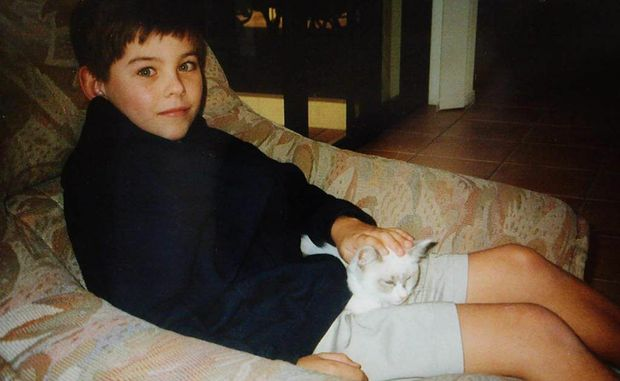 Daniel with the family cat.