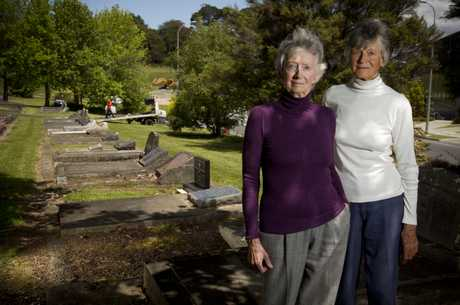 Sisters Janis Fairburn and Dinah Holman stand near their father A.R.D (Rex) Fairburn grave sight on next to the Albany Highway.