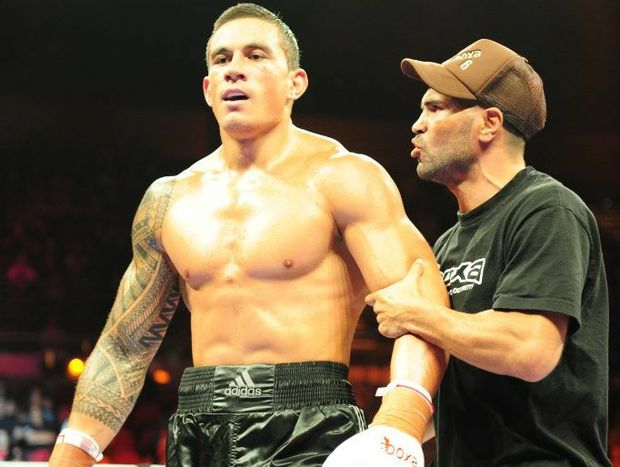 Anthony Mundine gives Sonny Bill Williams some words of advice as they walk back to their corner during Williams' fight at the Gold Coast Convention Centre last year.