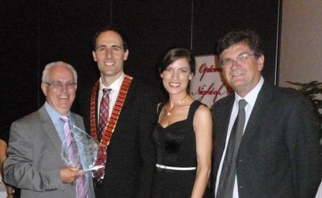 TOOWOOMBA Chamber of Commerce CEO Greg Johnson is presented an award for his contribution to optometry by Optometrist Association Australia president David Foresto, optometrist Liz Foresto and QUT Head of School of Optometry Professor Peter Hendicott.