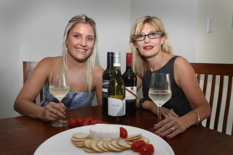 Ella Hickman and Zita Czigany toast to their taste buds. Photo Vicki Wood / Caboolture News