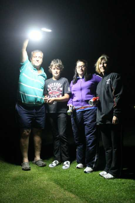 LIGHTS ON: Stanthorpe Sports Association president John Hendry, junior cricketer Spencer Jensen and Football Stanthorpe secretary Jaye Messina and treasurer Kerry Featherstone image all the night-time sports they will be able to play once the new CF White Oval lights are installed. Photo Linden Morris / Stanthorpe Border Post