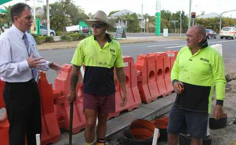 Mayor Gerard O&#39;Connell inspects work on the Woodstock St footpath with Tyrone Hopgood and Ross Fraser from QCivil.