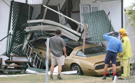 A Transam American muscle car failed to take a corner and crashed into a Hook Street house. Photo: Chris Ison / The Morning Bulletin