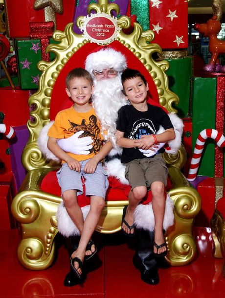 HAPPY KIDS: Riley, 7, and Lachlan Jones, 5, of Goodna with Santa at Redbank Plaza.