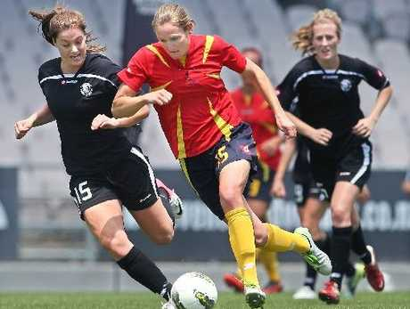 WaiBOP women's football team player Helen Collins (centre) looks to have gotten around the defence of the Northern Football team during their match at the Rotorua International Stadium.