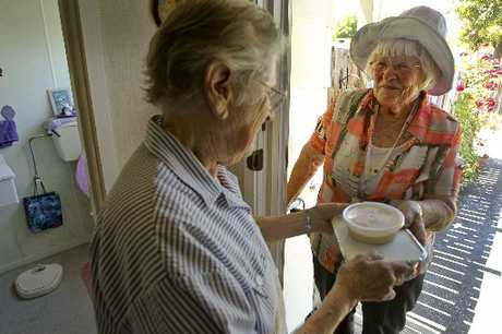 Hastings resident Johannah Maaka receives his meals on wheels from Pat Berry, who has been delivering them for 34 years.