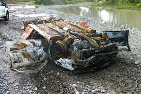POLLUTION EYESORE: A burnt-out car wreck dumped in the Waimakariri riverbed recently at Baynons Rd.