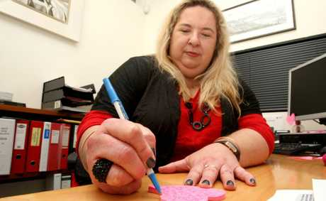 Susi Muddiman doodles at her desk. Photo: Blainey Woodham / Tweed Daily News