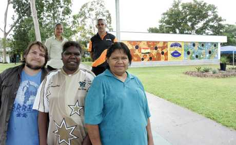 Work for the dole project participants Isaac Sleeman, Falma Rodger and Ann Butler with (back) Buderoo Employment and Training staff Rennae Hong and Joe Butler show off a mural at Mr Archer State School. Photo Sharyn O'Neill / The Morning Bulletin