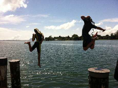 Leanne Cashmore captured the moment Stella Cashmore and Ella Westenberg jumped off the Plummers Point Road wharf.