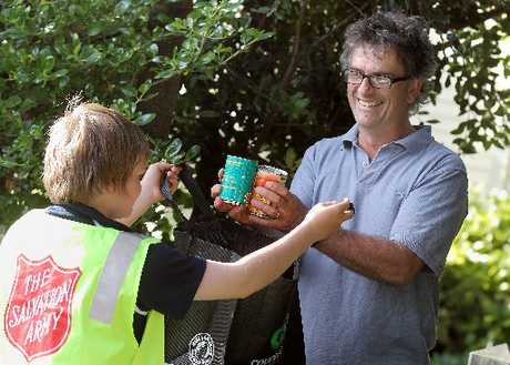 Glenholme&#39;s David Spiers (right) passes his foodbank contribution to volunteer Jayden Turton, 13.