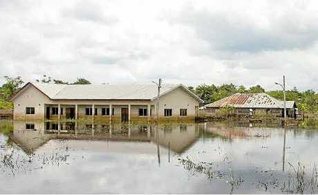 GOING DOWN: Flood waters recede slowly near Akinima, Rivers State, Nigeria.