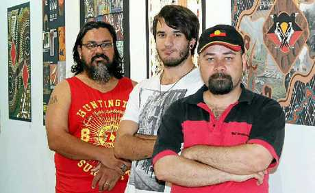 UNIQUE SKILLS: Artists Anthony Proberts, Tyler Wortley and Eric Ferguson were some of the nine students of the Diploma of Aboriginal Graphic Design at Lismore TAFE.PHOTO: Ebony Braddon