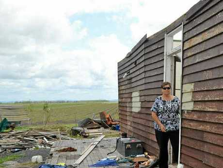 STORM DEVASTATION: Sue Haynes stands in the doorway of the farmhouse rented by her daughter. The place is unliveable, after the roof was blown off in a recent storm.