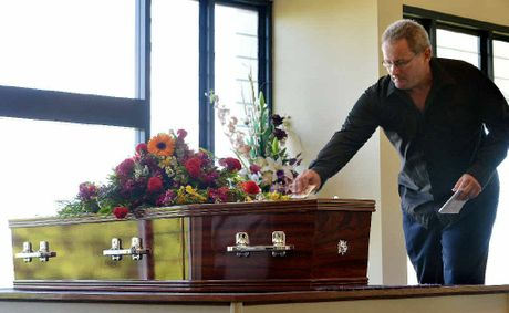 Bruce McKean's nephew, Shaun Halson, places a special card on his coffin. Bruce sent it to his mother in thanks when he turned 21.