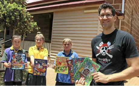 Well-known children's author Cameron Stelzer (right) passed on some skills to primary school students at a workshop yesterday including (from left) Jayden Lamb, Amy Whear and Nikita Smith.