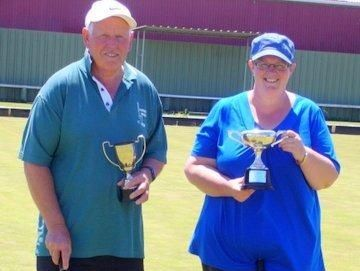 FAMILY SILVER: Terry and Carissa Price with the trophies they won at the Wanganui open tournament.
